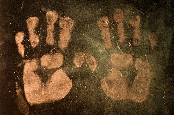 hand prints from very dirty hands. Shows how germs move from hands to surfaces.