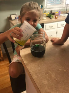 Adding olive oil on top of food coloring